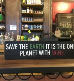 "Photo of ""Save The Earth It Is The Only Planet With Wine"" Wooden Sign"