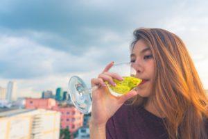 drinking wine on a balcony photo