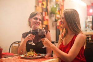 women drinking red wine photo
