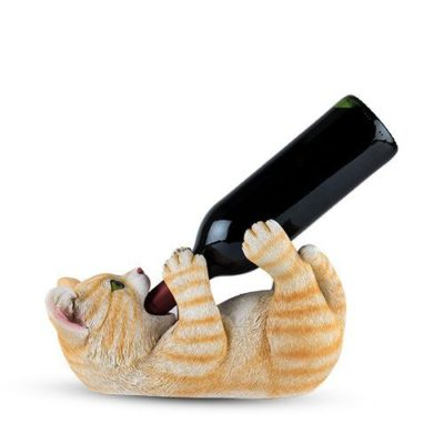 Photo of tippler tabby cat with bottle